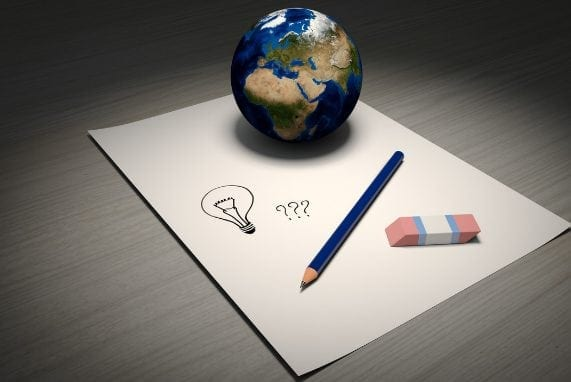 resources, Globe placed on paper with pencil and eraser