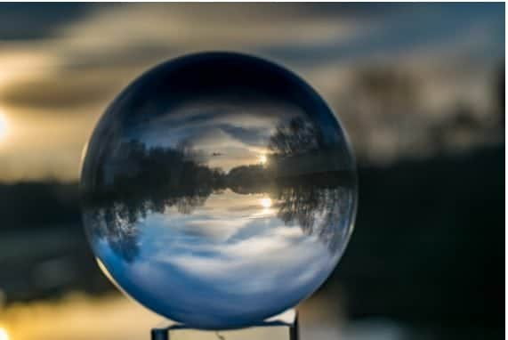 Contact Us, Crystal ball reflecting a clear sky and land
