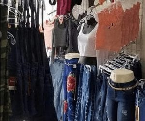 Dress Code Houston, ladies clothes on racks