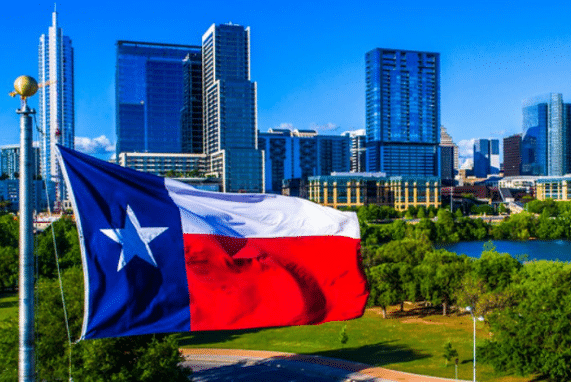 Dress Code Houston, Texas flag and city in the background
