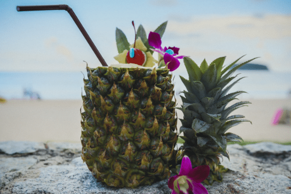 Travel, photo of drink in pineapple on sand