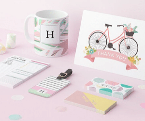 pink background cup and notepad