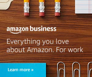 Business Resources, image of a closeup desk with pencils and paper clips. Amazon logo in white font